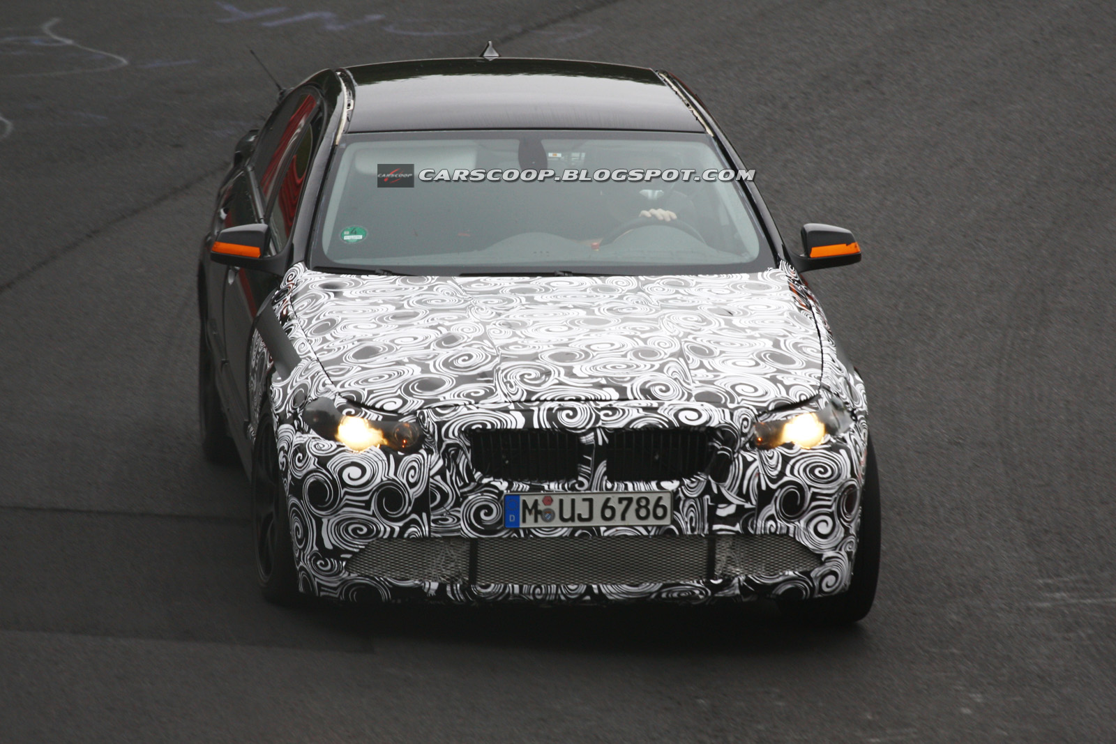 BMW M5 with twin turbo charged V8 spied