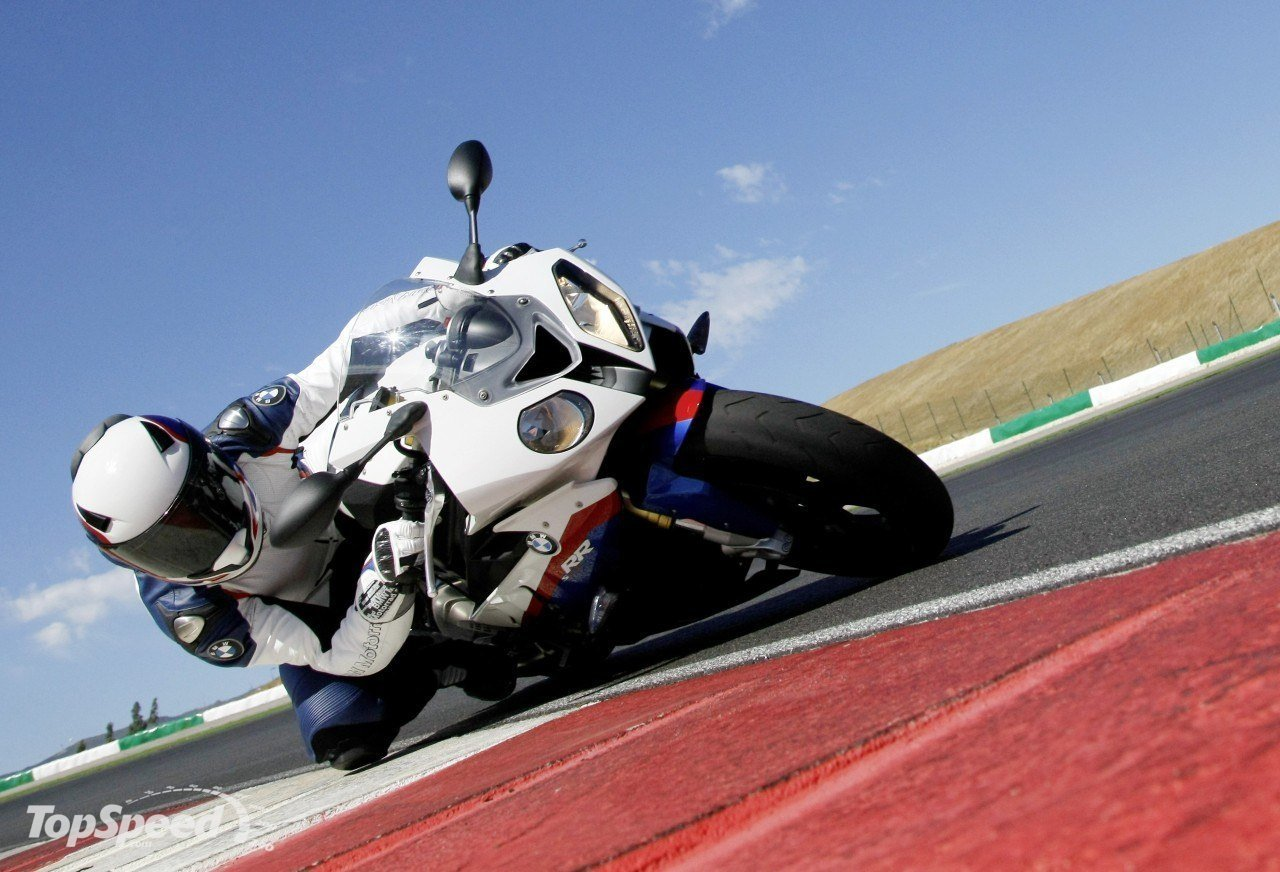 BMW S1000RR competing with a Corvette