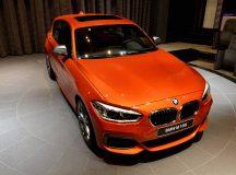 BMW M135i in Valencia Orange Gets Proper Attention at Abu Dhabi Dealership